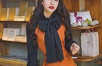 长裙外搭毛衣,冬季的时尚潮流